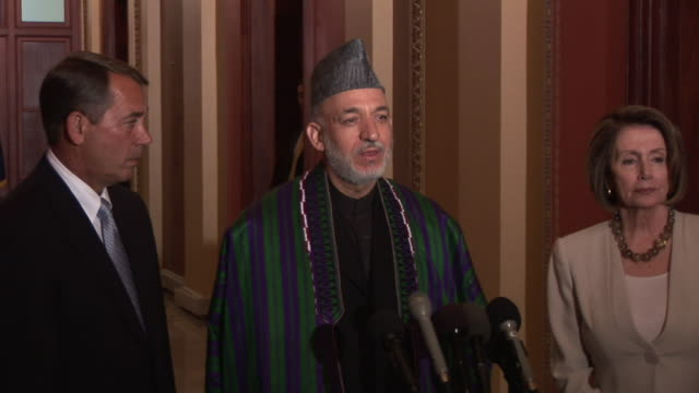 May 2009 MS ZI President of Afghanistan Hamid Karzai addressing the media during a visit to the US House of Representatives with Nancy Pelosi Speaker...
