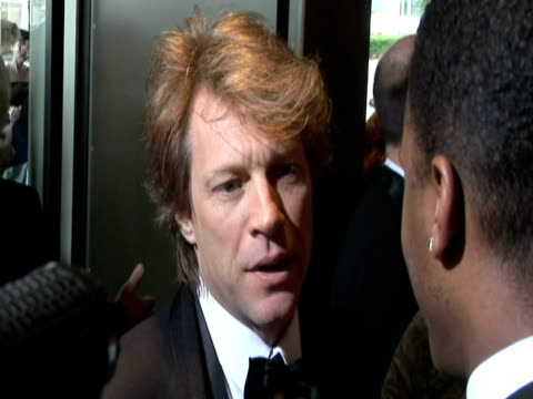 May 2009 CU Singer Jon Bon Jovi speaking to reporter at the White House Correspondents' Dinner/ Washington DC USA/ AUDIO