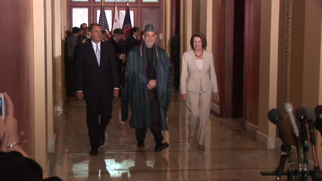 may 2009 ws zo zi speaker of the house nancy pelosi and house minority leader john boehner welcoming afghan president hamid karzai at the us house of... - speaker of the house stock videos and b-roll footage