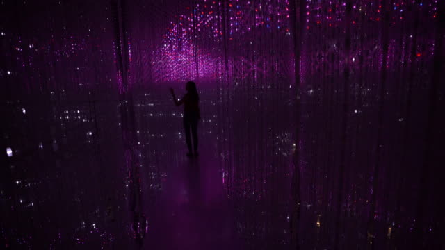4k footage silhouette girl with colorful light illumination in future world at singapore art science museum singapore - textured effect stock videos & royalty-free footage