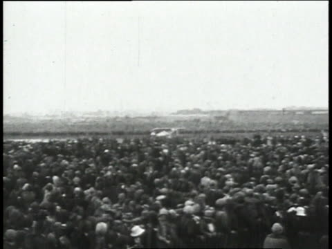 May 21 1927 MONTAGE Lindbergh lands plane in front of large crowd then makes an announcement after making historical flight / Paris France