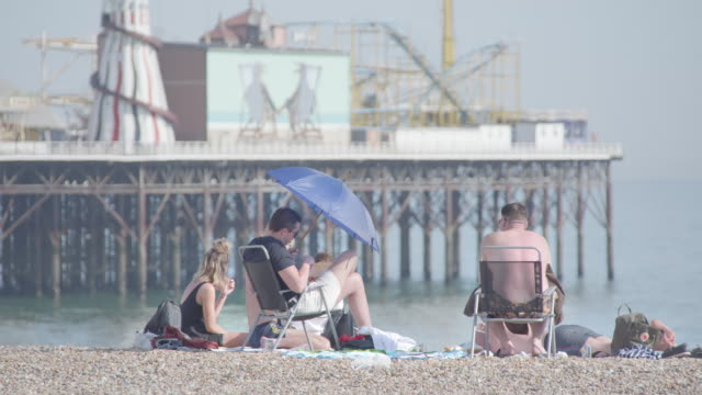 a family enjoys a picnic on brighton beach on the hottest day of the year so far may 21 2020 in east sussex england the uk has eased lockdown... - getting away from it all stock videos & royalty-free footage