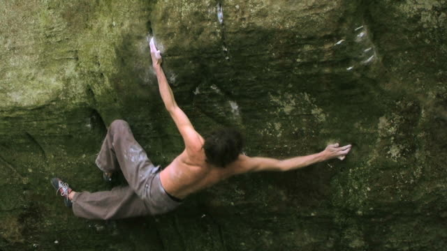 may 22 2009 montage a professional rock climber bouldering with the help of a spotter and a crash mat - crimped hair stock videos and b-roll footage