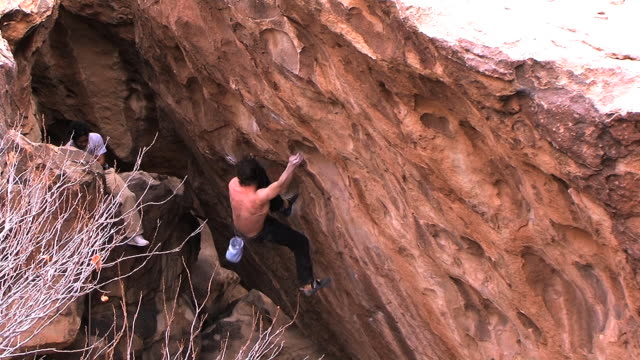 may 22 2009 montage a professional rock climber executing a climb known as a bouldering highball - crimped hair stock videos and b-roll footage