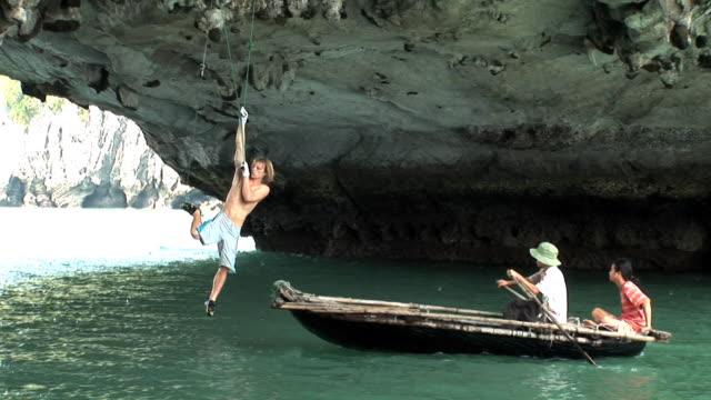 May 22 2009 MONTAGE A professional rock climber making a climb known as deep water soloing on a convex surface