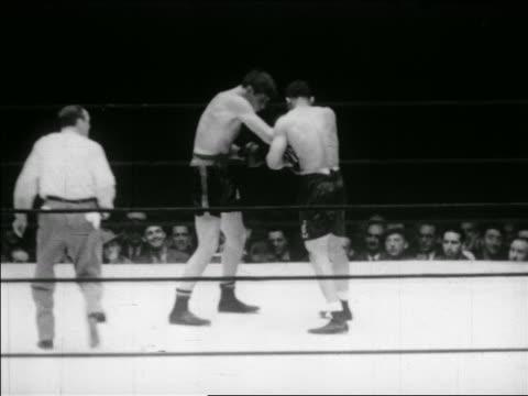 B/W May 23 1941 Joe Louis knocking out Buddy Baer in boxing match / series