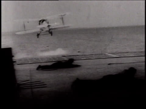 vidéos et rushes de may 24, 1941 montage fairey swordfish torpedo bombers taking off aircraft carrier hms victorious and flying in formation / north sea - groupe moyen d'objets