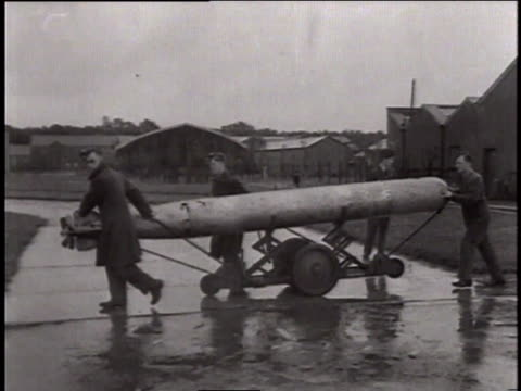 may 24, 1941 montage men rolling a torpedo beneath fairey swordfish torpedo bomber / north sea - torpedo stock videos & royalty-free footage
