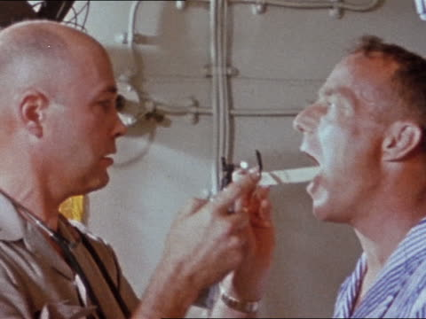 May 24 1962 astronaut Scott Carpenter getting medical exam after splashdown of Mercury 7 capsule