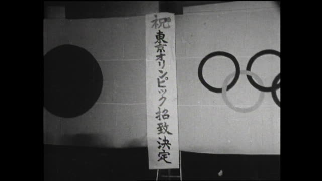 vídeos de stock e filmes b-roll de may 26 tokyo was elected as the host city of upcoming olympics at the 56th ioc general meeting held in munich west germany a banner informing that... - 1964