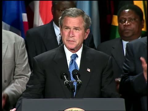 may 27 2003 ms george w bush taking applause and speaking at podium at annoucement of a us aids relief program for africa / washington dc / audio - only mature men stock videos & royalty-free footage