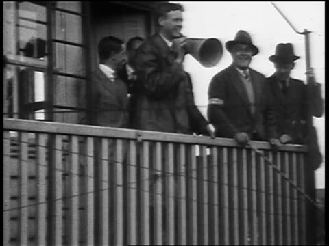 May 29 1927 B/W Charles Lindbergh smiling talking through megaphone at Croydon Airport with other people / London England