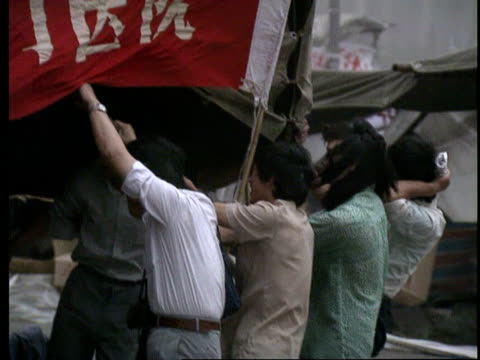 May 31 1989 MS PAN Dust storm in student protestor encampment in Tiananmen Square/ WS Dust storm/ Beijing China/ AUDIO