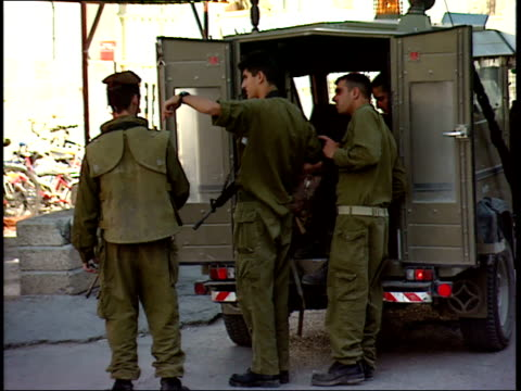 may 31, 1992 israeli defense soldiers conferring and patrolling on streets of business district / israel - israeli military stock videos & royalty-free footage