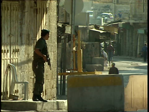 may 31, 1992 israeli soldier on duty looking out on quiet street / israel - israeli military stock videos & royalty-free footage