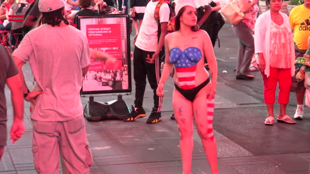 body painted topless in times square broadway and 7th avenue manhattan new york city usa - semi dress stock videos & royalty-free footage