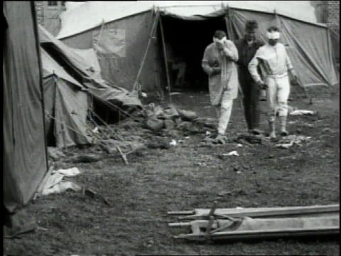 may 4 1918 montage attendant leading two bandaged gas victims through debris on ground of field hospital 13 / wendeuilcaply france - 1918 stock videos & royalty-free footage