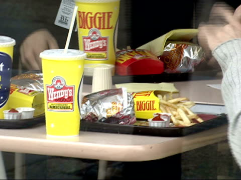 May 4 2005 CU Wendy's meal on table viewed through the window glass with people passing by in front / Washington DC United States
