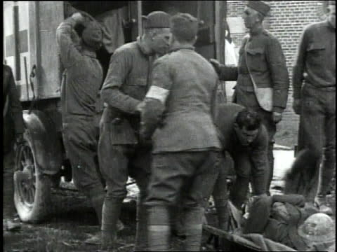 may 6 1918 ws american soldiers on stretchers and with bandaged eyes being unloaded from ambulance / froissy france - 1918 stock videos & royalty-free footage