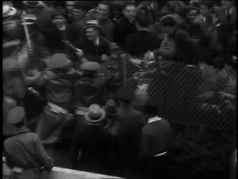 may 6, 1935 police clubbing at crowd along fence at kentucky derby / churchill downs, kentucky, united states - 1935 stock videos & royalty-free footage