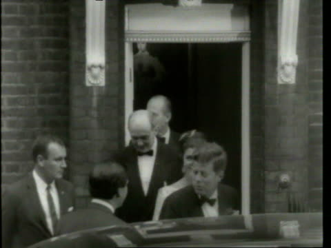 stockvideo's en b-roll-footage met may 6 1961 film montage ms john f kennedy jacqueline kennedy and dean rusk exiting building in formalwear/ cu john f and jacqueline kennedy/ ms... - jacqueline kennedy