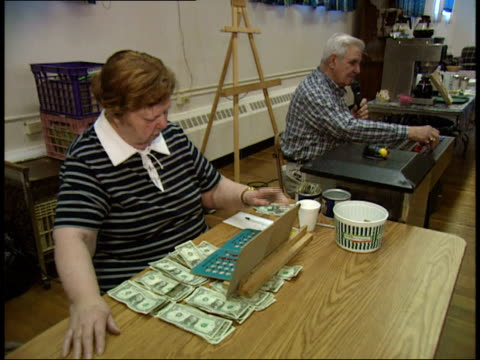 stockvideo's en b-roll-footage met may 6 2003 ha bingo cashier and caller running the game / massachusetts united states - bingo