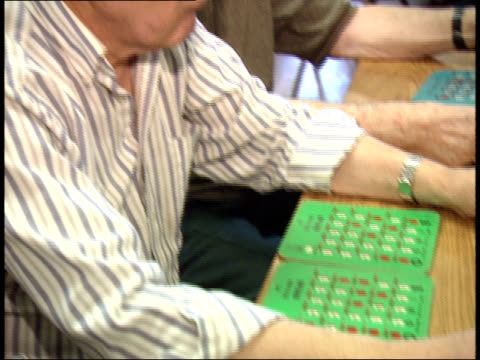 stockvideo's en b-roll-footage met may 6 2003 ha bingo players marking their cards /massachusetts united states - bingo