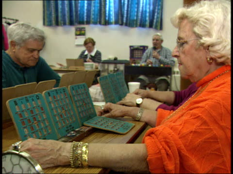stockvideo's en b-roll-footage met may 6 2003 ms player marking bingo cards / massachusetts united states - bingo