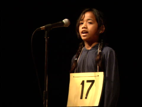 may 6, 2003 spelling bee contestant spelling recitalist correctly / massachusetts, united states - spielkandidat stock-videos und b-roll-filmmaterial