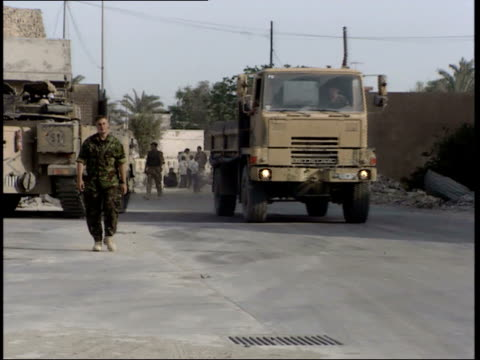 may 7, 1999 british army land rover escorting trucks and soldier on foot / basra, iraq - basra stock-videos und b-roll-filmmaterial