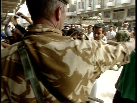 may 7, 1999 british army soldiers monitoring the distribution of newspapers / basra, iraq - basra stock-videos und b-roll-filmmaterial