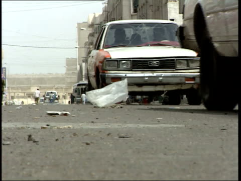 may 7, 1999 cars driving on an urban street / basra, iraq - basra stock-videos und b-roll-filmmaterial