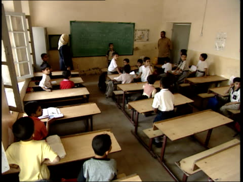 may 7, 1999 students and teacher inside classroom at school / basra, iraq - ethnicity stock videos & royalty-free footage
