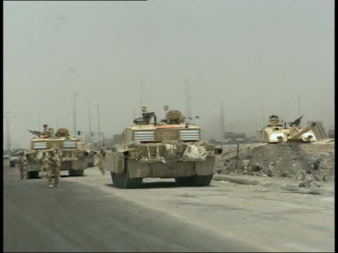 may 7, 1999 u.s. army soldiers and tanks on the side of a road / iraq - us military stock videos & royalty-free footage