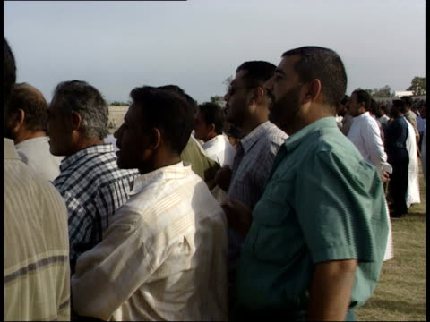may 8, 1999 montage fans watching soccer game in action / basra, iraq - basra点の映像素材/bロール