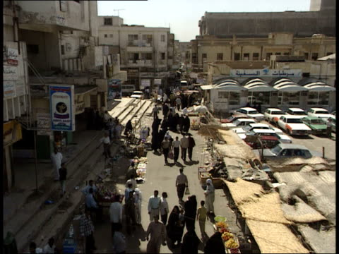 may 8, 1999 montage shoppers in the market / basra, iraq - basra stock-videos und b-roll-filmmaterial