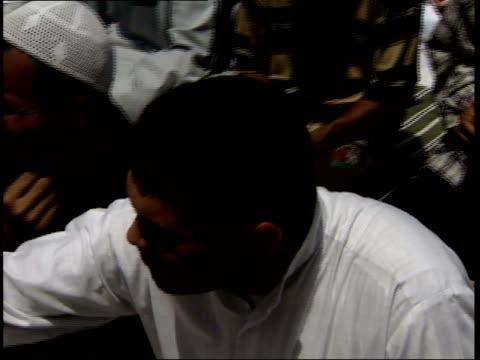 vídeos de stock e filmes b-roll de may 8 1999 ha muslims taking part in prayer rituals outside of a mosque / basra iraq - rasto de movimento