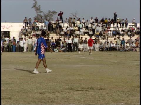 vídeos de stock e filmes b-roll de may 8 1999 ts soccer game in action with the teams competing for the ball / basra iraq - rasto de movimento