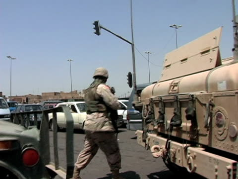 may 8 2004 soldiers escorting vehicles through city, baghdad, iraq, audio - three quarter length stock videos & royalty-free footage