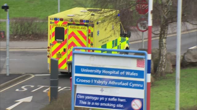 May apologises for cancelled operations as new figures reveal strain on NHS WALES Cardiff University Hospital of Wales Ambulances outside hospital as...