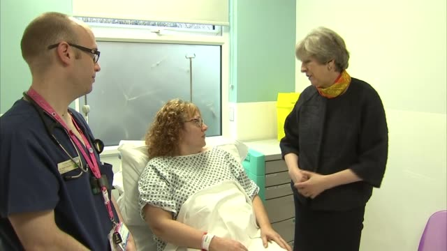 May apologises for cancelled operations as new figures reveal strain on NHS Surrey Frimley Frimley Park Hospital Prime Minister Theresa May MP and...