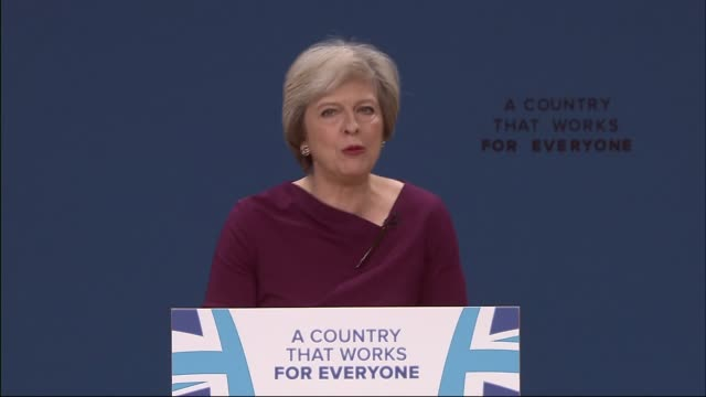 may at podium as gestures for audience to sit theresa may mp speech sot - do we have a plan for brexit? we do. are we ready for the effort it will... - david m. davis politician stock videos & royalty-free footage