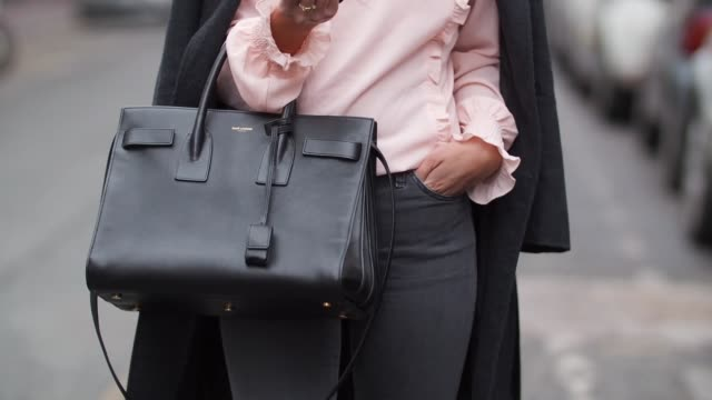may berthelot head of legal at videdressingcom and fashion blogger wears a lovie and co pink lace blouse top a tailored wool trench coat topshop gray... - blouse stock videos & royalty-free footage