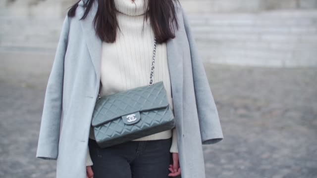 vídeos y material grabado en eventos de stock de may berthelot head of legal at videdressingcom and fashion blogger is wearing a chanel sweater topshop gray denim jeans zara black suede boots a... - denim