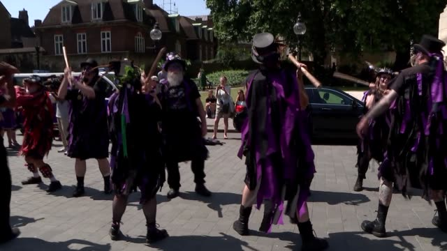 vídeos de stock e filmes b-roll de amber rudd joins morris dancers campaign to stop it being moved in 2020; england: london: westminster: ext various of morris dancers dancing outside... - dia do trabalhador