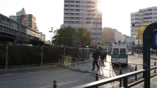 may day in kreuzberg germany on the 1st of may 2016 on a sunny day in kreuzberg near kottbusser tor on the left side police cars and police officers... - may day international workers day stock videos & royalty-free footage