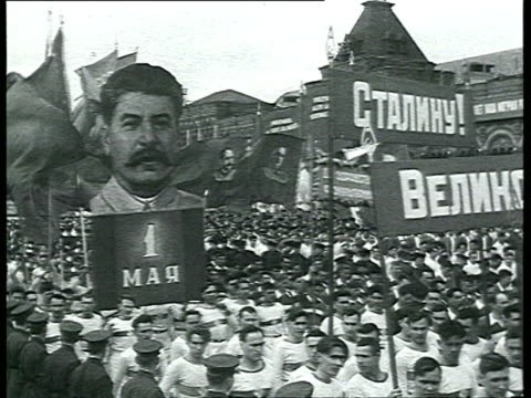 may day parade in red square crowd carrying banners with stalin and slogans stalin on lenin mausoleum kalinin malenkov kaganovich / moscow russia - former ussr flag stock videos & royalty-free footage