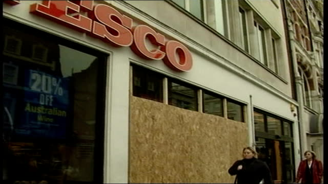 London aftermath ITN ENGLAND London Tesco store with boarded up windows GV Habitat shop ditto GV Barclays bank ditto