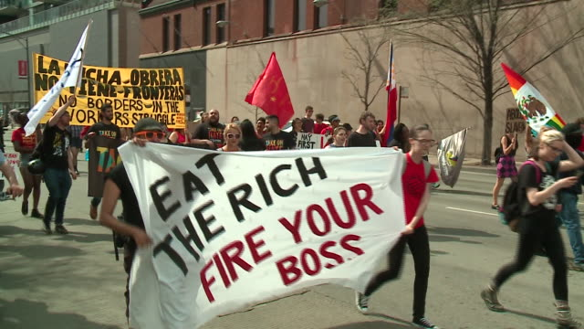 may day rally on may 1 drew together hundreds of union members immigrant activists and other groups calling for worker solidarity at the haymarket... - gewerkschaft stock-videos und b-roll-filmmaterial