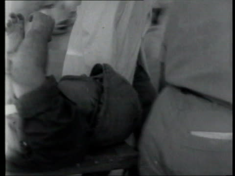 vídeos de stock, filmes e b-roll de may; in 1967 egypt and jordan unite against israel tx 8.6.1967 israel: gaza city: ext b/w footage wrecked buildings / wounded soldiers arriving at... - air raid